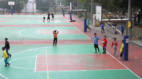 Boys Playing Basketball at the Tunghai University. HD Footage