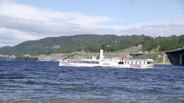 World Oldest Paddler Steamboat In Service Passing Minnesund Bridges Norway stock footage