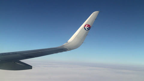 Aerial View with the Wing of China Eastern Airline's Plane. HD Footage