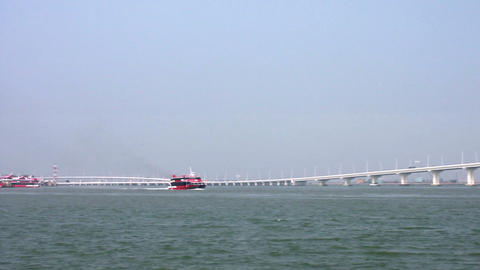 Jetfoils arriving and leaving Macau with view of Friendship bridge Footage