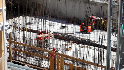 Workers in uniform at the construction site Footage