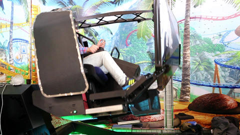 MOSCOW, RUSSIA - JULY 10, 2015: Visitors playing on redemption video simulator g Footage