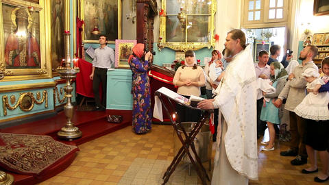 MOSCOW, RUSSIA - JULY 11, 2015: Christening of little baby in orthodox church on Footage