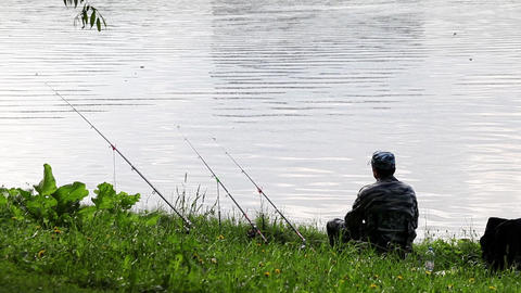 Fisherman Is Fishing On A River Bank stock footage