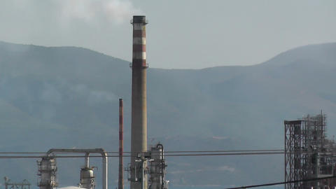 smoke stacks of industrial plant facility from motion camera Footage