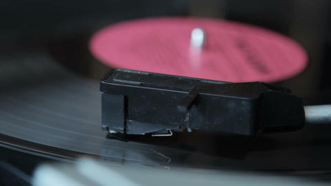 Record vinyl on turntable in vintage color tone Footage