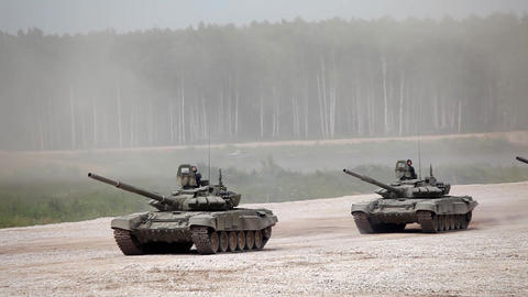 Military tanks driving along the road, Russian military convoy Footage