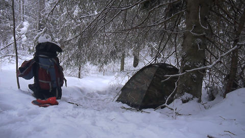 tent is among snowy winter forest Footage