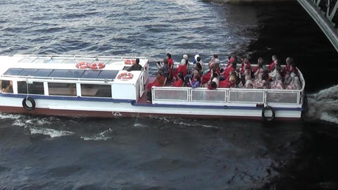 SAINT-PETERSBURG, RUSSIA - JUNE 12 Excursion boat comes up from under the bridge Footage
