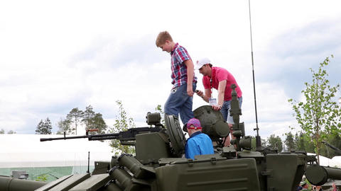 Kids on military tank. International military technical forum Army-2015 Live Action