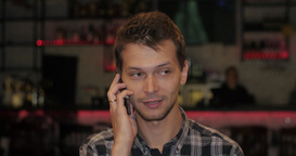 Man In A Cafe Talking On The Phone stock footage