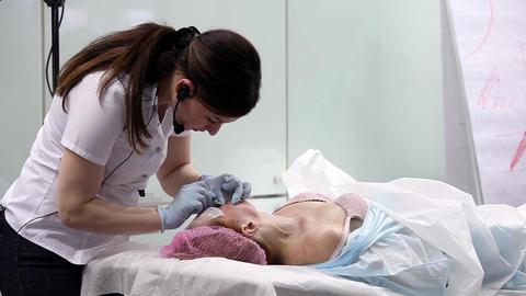 Woman having botox treatment in beauty salon Footage