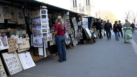 Selling posters in Paris Stock Video Footage