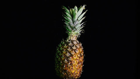 Big pineapple turning on itself Stock Video Footage