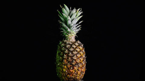Big pineapple turning on itself Footage