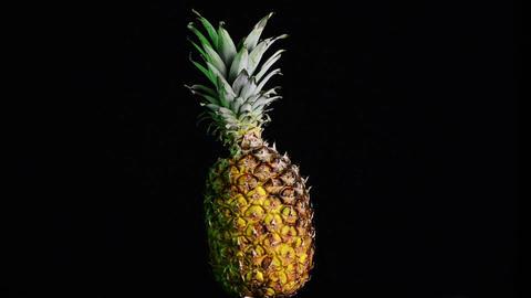 Big pineapple turning on itself Stock Video Footage