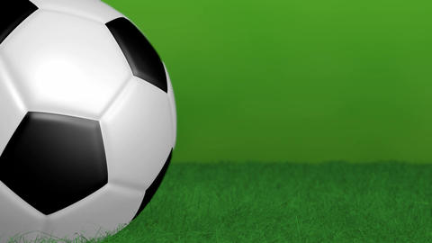 Green background with spinning soccer ball Stock Video Footage