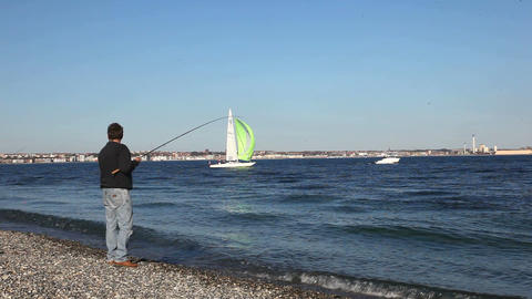 Fishing from shore Stock Video Footage