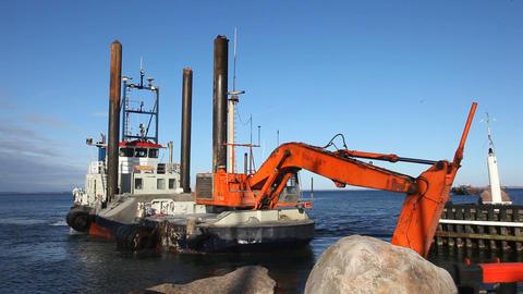 Sandexcavator on water Stock Video Footage