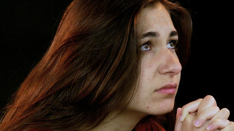 girl praying intense Stock Video Footage