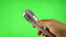 Holding Up A Microphone Isolated On Green Screen Footage