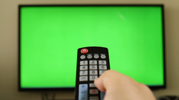 POV holding remote control with green screen inside tv LED screen Footage