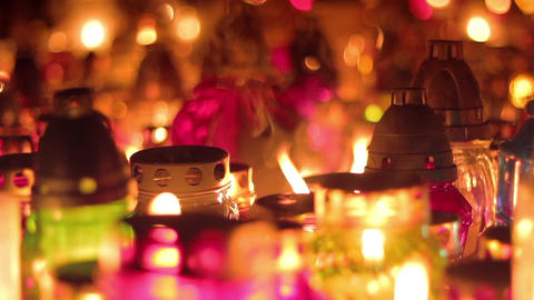 Candles And Open Flame Burning At Night In Cemetery stock footage