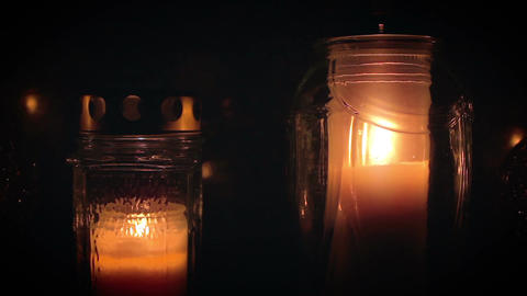Two Candles In Foreground Glowing In The Darkness stock footage