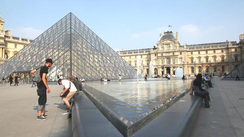 The Fountaine at the Peis Pyramide at Louvre Museeum Stock Video Footage