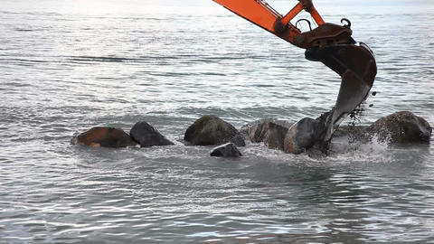 A excavator digging big stones Stock Video Footage