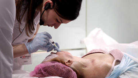 Woman Having Botox Treatment In Beauty Salon stock footage