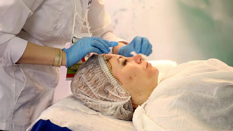 Woman having cosmetic procedures in beauty salon Live Action
