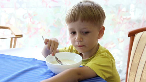 The little boy eats porridge Footage