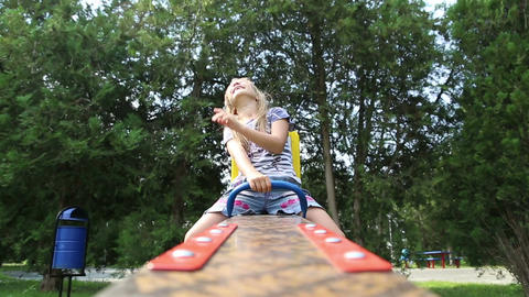 Little girl riding seesaw Footage
