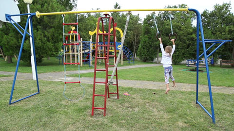 Girl Playing On The Playground stock footage