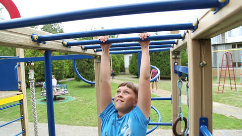 The Boy Clings To A Horizontal Bar stock footage