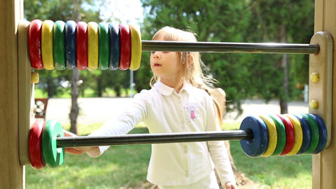 Girl Playing On The Playground With Abacus stock footage