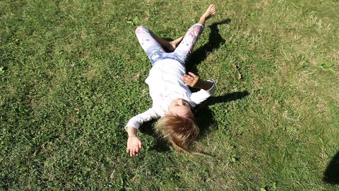 Girl somersault on grass lawn Live Action