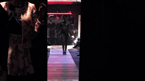 Awkward Catwalk Of The Female Model On The Runway stock footage