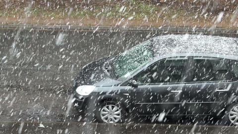 Heavy snowfall on the residential street - snow-covered car 2 Footage
