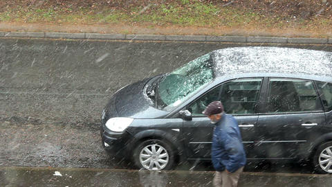 Snowfall on the residential street - pedestrian walking through Footage