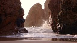Rocks and Surf Backlit Sun Footage