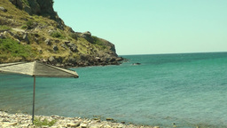 Greek Beach And An Umbrella1 stock footage