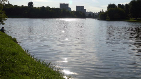 The Lake With The Fisherman And Sun Path (reflection) Of Russia In The Summer Of stock footage