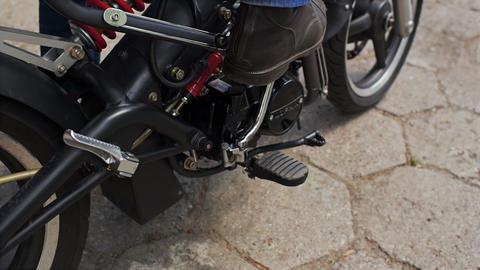 Biker starts motorbike Live Action