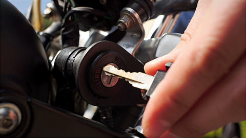 Man Having Problem With Putting Key Into Motorbike Ignition stock footage