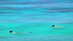 Snorkeling kids in turquoise lagoon, Sumatra, Indonesia Footage