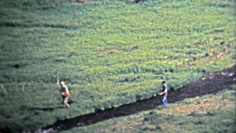 1972: Fly Fishermen Fishing On Small Alpine Stream stock footage