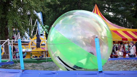 Kids in zorb bubble ball swimming in pool Footage