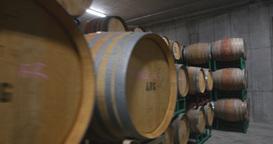Steadicam Barrels Of Wine In A Cellar stock footage